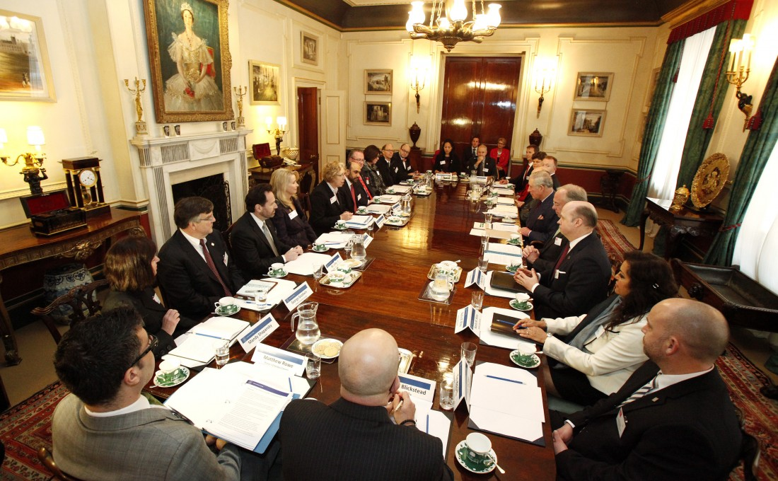 The Team Canada delegation gathers in a dining room at Clarence House for a private audience with HRH The Prince of Wales.