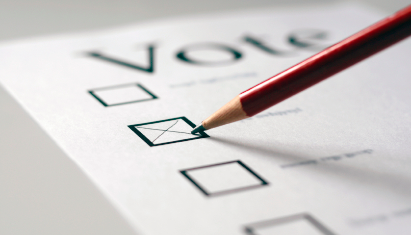 Voting card with a pencil ticking a box