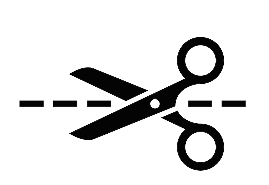 Scissors cutting along a dotted line