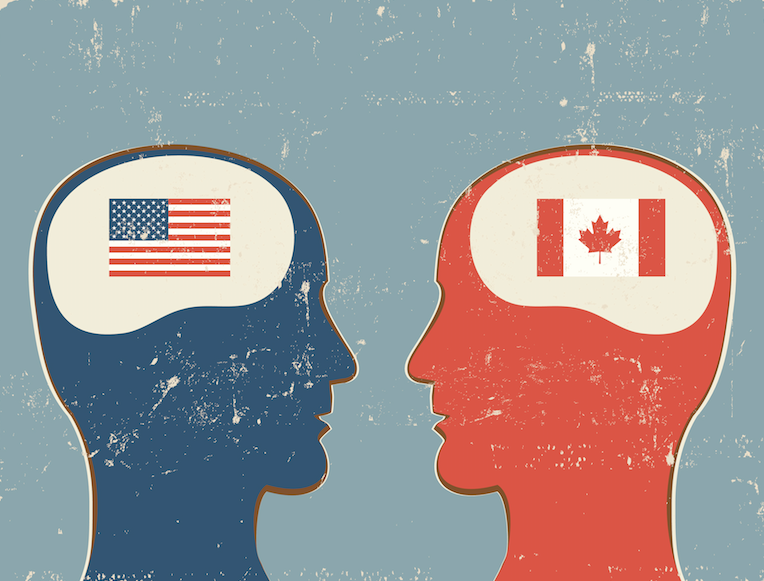 Human profiles with United States and Canadian flags