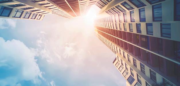 Futuristic skyscape with sun shining through